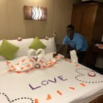 Roomboy Carpe Novo Maldives proudly showing his towel and room decorations
