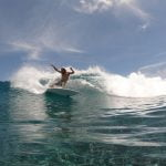 Having fun while surfing in the Maldives