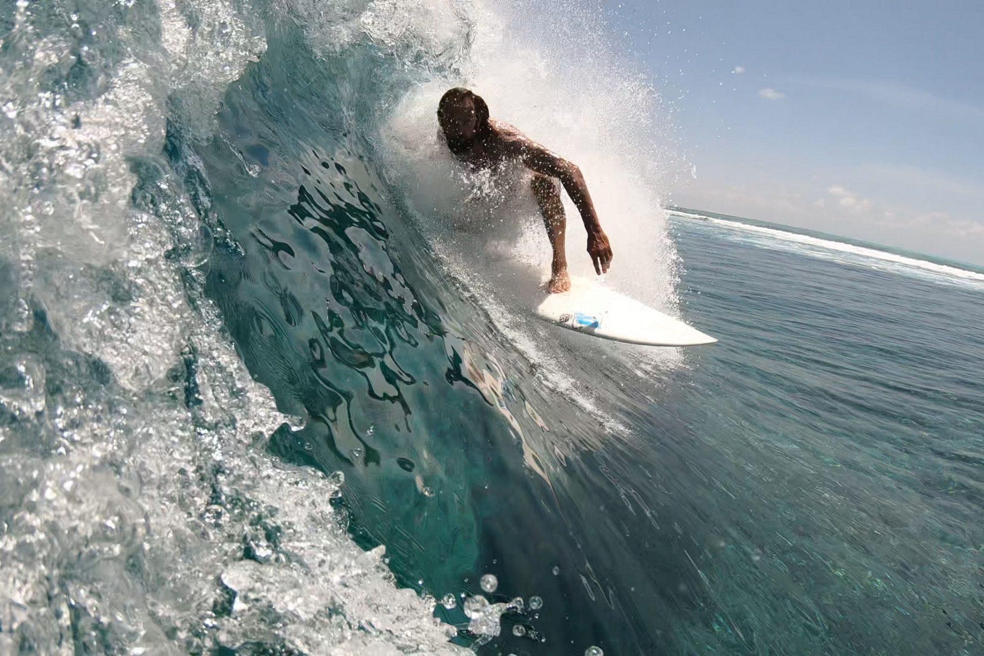 Wave surfing Maldives